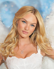 Candice Swanepoel's blue eyes were brightened by a sweep of liquid liner and shimmering peach shadow at the launch of Victoria's Secret Angel fragrance and the Dream Angels bra.