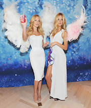 Candice Swanepoel was sexy at the Victoria's Secret launch party in NYC in a white cocktail dress complete with a bustier top. She topped off the look with classic nude stilettos.