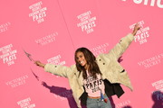 Cindy Bruna flew to Paris for the 2016 Victoria's Secret fashion show wearing a chic nude fur jacket.