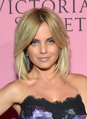 Mena Suvari added a pair of statement-making earrings for the Victoria's Secret What Is Sexy? party.