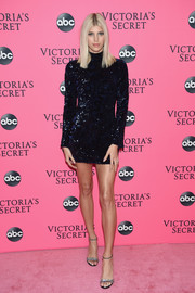 Devon Windsor sparkled in a sequined turtleneck dress by Alexis at the Victoria's Secret viewing party.