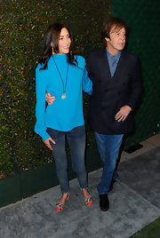 "Nancy Shevell looked vibrant at the premiere of Paul McCartney's ""My Valentine"" music video in this silky aqua blouse."