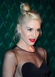 Gwen Stefani wore a fresh-faced makeup look at the video premiere of 'My Valentine' but added a touch of drama with rich matte red lipstick.