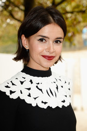 Miroslava Duma wore her hair short and straight with just a hint of a flip during the Viktor & Rolf fashion show.