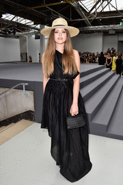 Kristina Bazan donned an asymmetrical black maxi dress for a goth-chic vibe at the Viktor & Rolf Couture show.