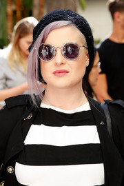 Kelly Osbourne attended the Villoid garden tea party wearing ultra-modern round shades.