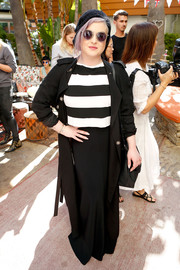Kelly Osbourne paired an elegant black maxi skirt with a boldly striped top for her Villoid garden tea party look.