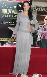 Michelle Rodriguez looked like a medieval princess in her long-sleeve gray evening dress during Vin Diesel's Hollywood Walk of Fame ceremony.