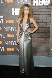 Juno Temple looked alluring in a metallic silver halter gown at the New York premiere of 'Vinyl.'