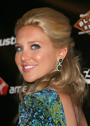 Stephanie Pratt paired her printed dress with matching emerald green earrings.