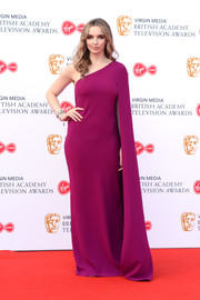 Jodie Comer looked divine in a magenta Stella McCartney gown with a single cape sleeve at the 2019 Virgin Media British Academy Television Awards.