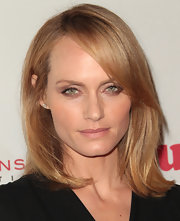 Amber Valletta wore her hair cut in a medium-length bob with side-swept bangs for Virgin United's 5th Annual Rock the Kasbah event.
