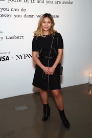 Chloe Kim continued the edgy vibe with a pair of black lace-up boots.