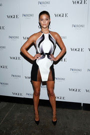 Nina Agdal left little to the imagination with this monochrome sheer-panel halter mini during the Visionary World of Vogue Italia exhibition.