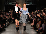 Vivienne Westwood complemented her ladylike outfit with a pair of black mid-calf boots during her Autumn 2011 fashion show.