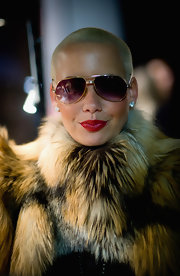 Amber Rose paired her furry coat with gold rimmed aviator shades.