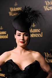 Dita was a show stopper at the Vivienne Westwood store opening party in a dramatic black feathered hat.