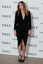 Suki Waterhouse completed her all-black look with a pair of laser-cut platform pumps by Charlotte Olympia.