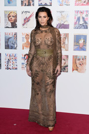 Kim Kardashian was in skin-revealing mode, as usual, at the Vogue 100 Festival Gala, where she wore this sheer, embroidered gown by Roberto Cavalli.