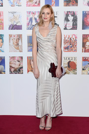 Laura Carmichael looked effortlessly chic at the Vogue 100 Festival Gala in a white cowl-neck dress with tonal stripes.