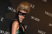Lara Stone pumped up the volume while attending Vogue's Anniversary Party.