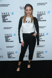 Jesinta Campbell went casual in a long-sleeve white T-shirt for the Vogue American Express Fashion's Night Out in Melbourne.