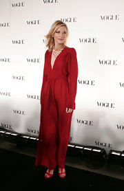 Cate pairs red t-strap pumps with her gown.