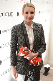 Emma Roberts' zipper pouch red clutch was the perfect pop of color for her printed monochrome outfit.
