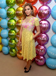 Eva Mendes chose this yellow and pink lace frock for a bright and feminine look at the Vogue Eyewear launch.