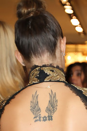 Isabeli Fontana attended Fashion's Night Out in Paris with an open-backed gown that showcased her winged tattoo