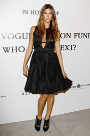 Melissa's LBD was right on trend with its pleats and deep-plunging V-neck.