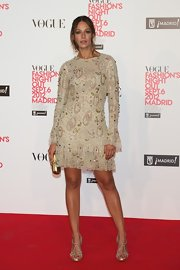 Eva Gonzales stepped out at the 'Vogue' event wearing a pair of metallic heels.