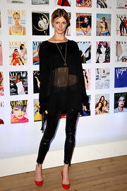 Jacquetta Wheeler looked very modelesque in her sheer black blouse and leather leggings at the Vogue Festival.
