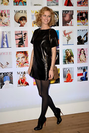 Eva Herzigova looked chic and sexy in this leather shift dress at the Vogue Festival.