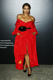 Kat Graham channeled Rihanna with this baggy red off-the-shoulder dress by LVR at the Vogue Italia New Beginning party.