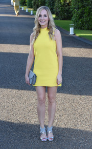 Joanne Froggatt styled her dress with a pair of gray and silver crisscross-strap sandals, also by Ralph Lauren.
