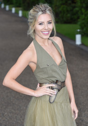 Mollie King styled her halter top and tulle skirt combo with a distressed metallic belt when she attended the Wimbledon party.