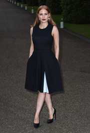 For her Wimbledon party look, Jessica Chastain opted for a minimalist Ralph Lauren LBD, with just a sliver of white peeking from the folds of the skirt.