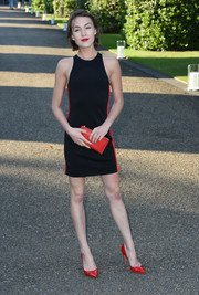 Ella Catliff styled her dress with a pair of red patent pumps, also by Ralph Lauren.