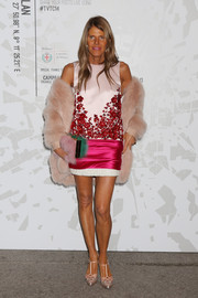 Anna dello Russo injected a playful touch with a two-tone fur clutch by Sara Battaglia.