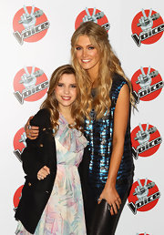 Delta Goodrem went for a sparkly look at the 'Voice' press conference in a blue sequined top.