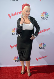 Christina Aguilera attended the 'Voice' karaoke for charity event wearing a cute black-and-white track jacket.