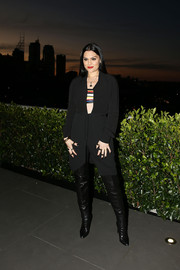 Jessie J attended the 'Voice' live finals show launch wearing what looked like a black wrap dress with a plunging neckline and a striped bandeau underneath.