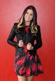 Cassadee Pope was sweet and edgy at the same time in a rose-print dress and a leather jacket during the debut of her album.