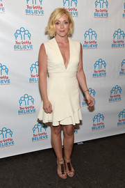 Jane Krakowski went for a flirty vibe in a deep-V, wave-hem LWD at the Voices for the Voiceless event.