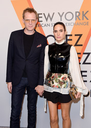 Jennifer Connelly accessorized with a metallic box clutch by Louis Vuitton at the 'Volez, Voguez, Voyagez' exhibition opening.