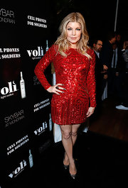 Fergie was dressed in a sexy holiday red for December at the Volo Light Vodka celebration.