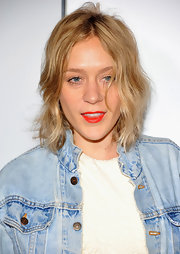 Chloe Sevigny injected a bit of color into her look with a swipe of tomato red lipstick.