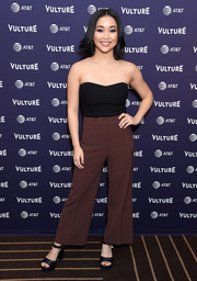 Lana Condor teamed her top with a pair of cropped flare pants.