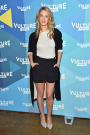 Yael Grobglas kept it breezy in black AllSaints shorts teamed with a gray knit top on day 1 of the Vulture Festival.